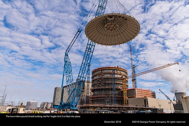 The two million pound shield building roof for Vogtle Unite 3 is lifted into place