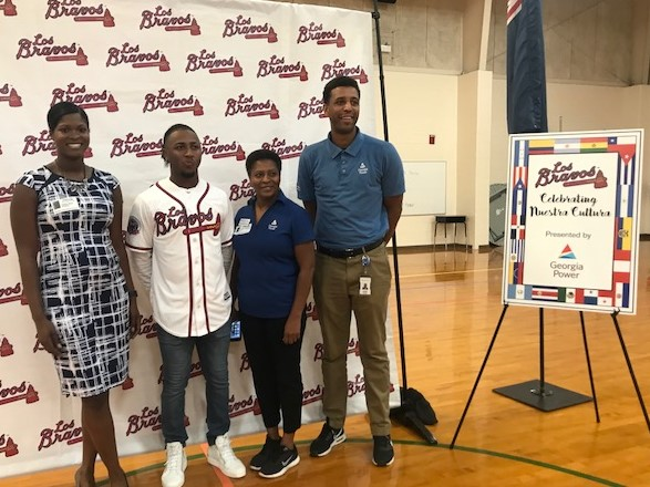 Atlanta Braves second baseman Ozzie Abies surprised students at Dunleith Elementary School with a Q&A session. Pictured Left to Right: Ashley West, media relations; Ozzie Albies; Deborah Pendergrass, education coordinator; and Terry Owens, education coordinator.
