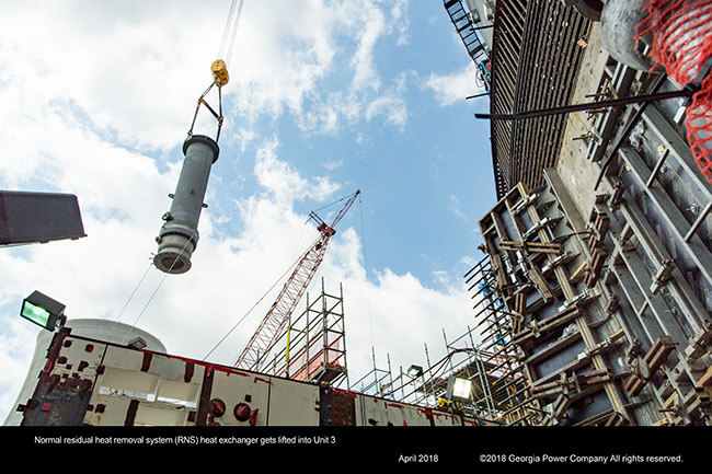 Normal residual heat removal system (RNS) heat exchanger gets lifted into Unit 3