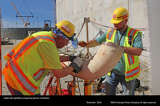 Vogtle 3&4 pipefitters preparing pipe for installation