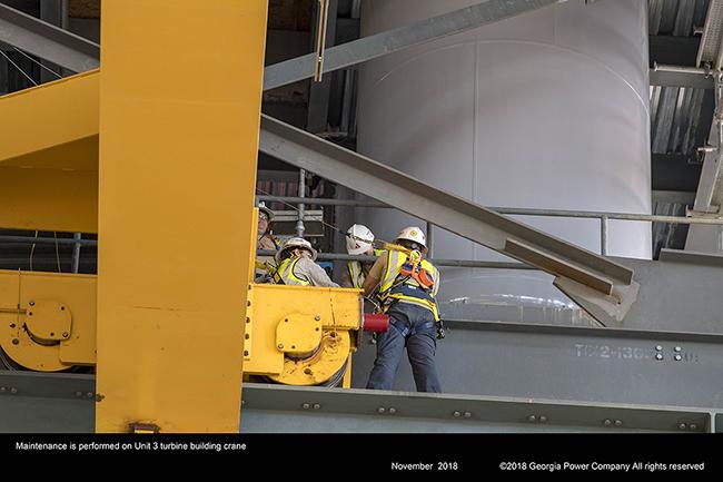 Maintenance is performed on Unit 3 turbine building crane