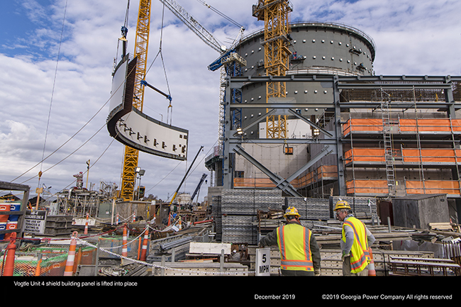 Vogtle Unit 4 shield building panel is lifted into place