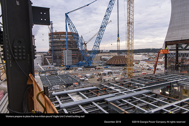 Workers prepare to place the two million pound Vogtle Unit 3 shield buliding roof