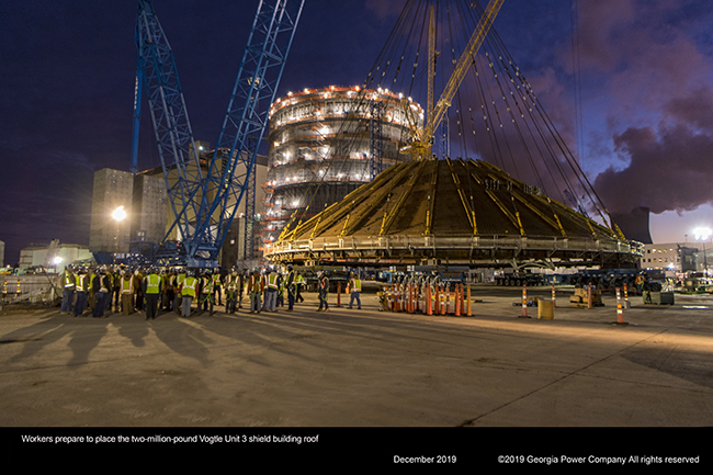 Workers prepare to place the two million pund Vogtle Unit 3 shield building roof