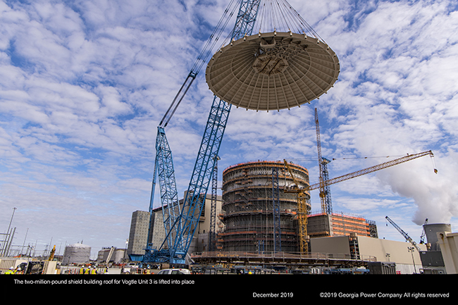 The two million pound shield building roof for Vogtle Unit 3 is lifted into place