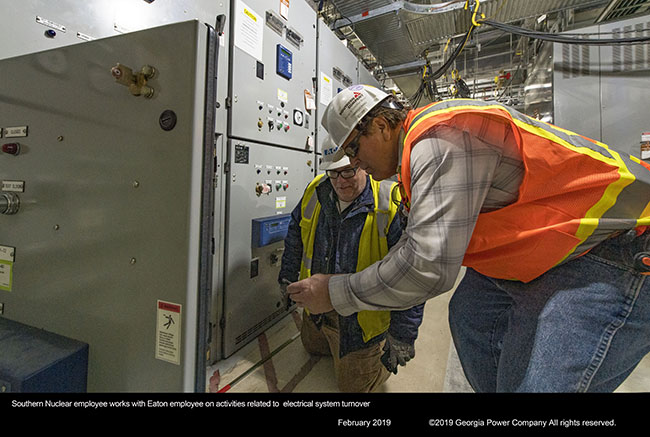 Southern Nuclear employee works with Eaton employee on activities related to electrical system turnover