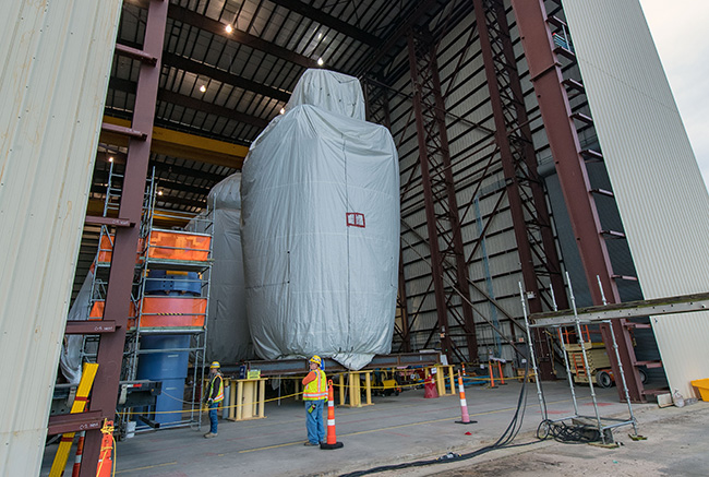 Unit 3 integrated head package staged inside modular assembly building