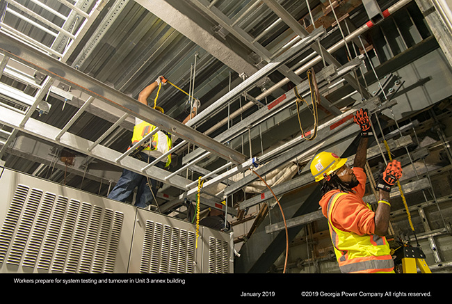 Workers prepare for systems and turnover in Unit 3 annex building