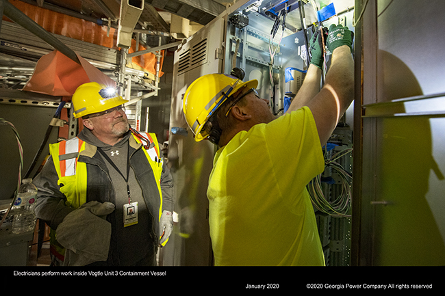 Electricians perform work, inside Vogtle Unit 3 Containment Vessel