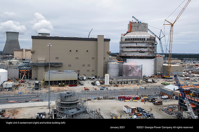 Inside Vogtle Unit 4 containment (right) and turbine building (left)