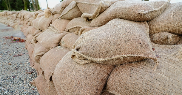 A long wall of sandbags in place for flood protection.