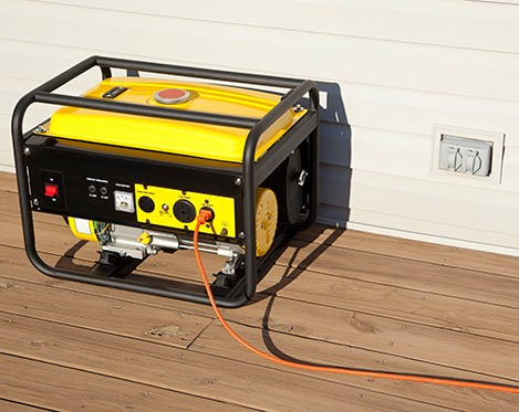 """Extension cord plugged into a gasoline powered, 4000 watt, portable electric generator.Please also see;"""